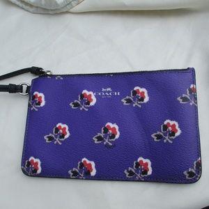 Authentic Coach Purple wristlet Brambling rose